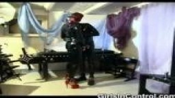 Latex couple in domination roleplay in the basement