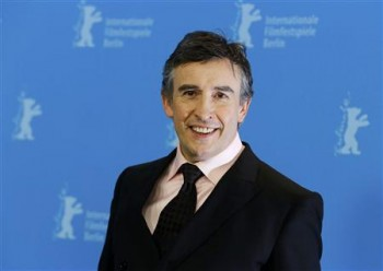 """Actor Coogan poses during a photocall to promote the movie """"The Look of Love"""" at the 63rd Berlinale International Film Festival in Berlin"""