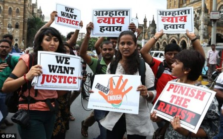 'Punish the rapist': Activists fight for justice during a protest rally in Mumbai (file photo)