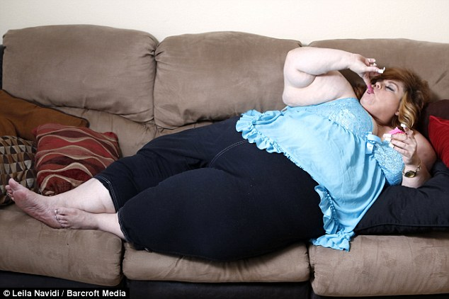 Fat woman eating donuts