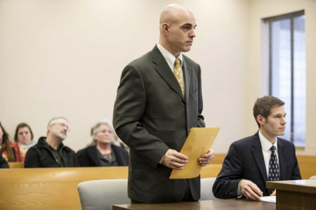 Detective David Blackmer, standing, was sentenced to jail time on cyberstalking charges in Snohomish County Court on Wednesday.