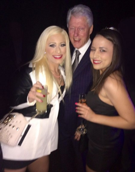 Bill linton poses with two prostitutes