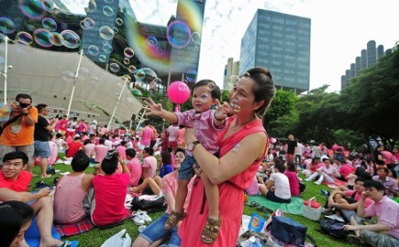 """People dressed in pink attend the """"Pink Dot"""" held in Singapore's Hong Lim Park on June 28. Photo: Xinhua"""