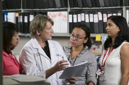 From left: Susana Rivera, nurse clinician, Sally Hodder, HIV program director, Christie Lyn Costanza, research coordinator and Shobha Swaminathan, associate HIV program director, discuss HIV prevention methods at Rutgers New Jersey Medical School in Newark. (Steve Hockstein)