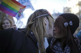 449589-students-kiss-as-they-march-through-the-streets-of-paris-in-support-of