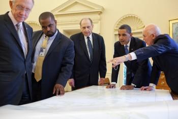 Harry Reid (far left) and LDS leaders, President Thomas S. Monson and Elder Dallin H. Oaks, (center and far right) presenting family history to President Obama.