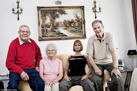 One of the family: Carl, (right), 56, lives with his parents, Geoffrey and Doreen and his doll Alektra. He was divorced from his wife 20 years ago and did try dating, but after eight years still had not met the right woman, sparking his interest in dolls. He bought the first one in 1998, and although he still has her she is packed away. Alektra, who is modelled on American porn actress Alektra Blue, is his latest purchase. Carl does not have a sexual relationship with Alektra and does not see her as a girlfriend, but solely as a doll who he likes to photograph but who will never be able to replace a real woman. He is still hoping to meet the love of his life.