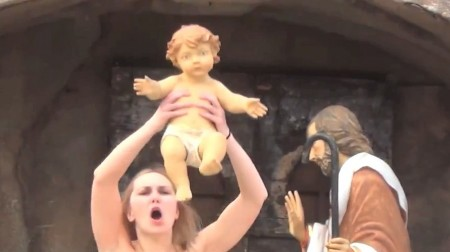 Topless Feminist Steals Baby Jesus From Vatican Nativity Display