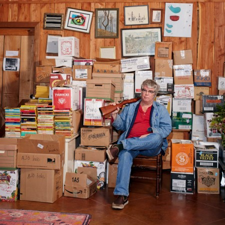 Chris Offutt at home with his father's files and assorted heirlooms. William Mebane for The New York Times
