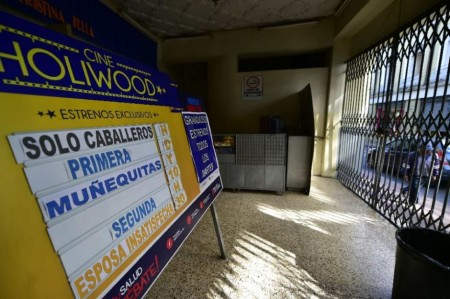 A board at the Hollywood porno cinema in Quito, advertises the latest movies as well as warning only men are allowed, on March 6, 2015 (AFP Photo/Rodrigo Buendia)