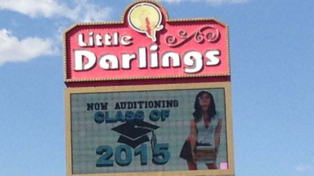 The marquee for the Little Darlings strip club in Las Vegas encourages recent high school graduates to apply for employment. (Danielle Miller/FOX5)