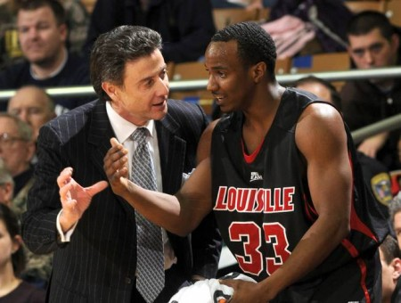 JOE RAYMOND / AP This Feb. 12, 2009, file photo shows Louisville coach Rick Pitino, left, talking with guard Andre McGee during the first half of an NCAA college men's basketball game against Notre Dame in South Bend, Ind. Louisville said Friday, Oct. 2, 2015, it has launched an investigation into allegations that former Cardinals staffer McGee paid an escort service to provide sex for recruits.