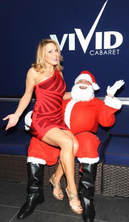 Savanna Samson and Santa Claus share a laugh